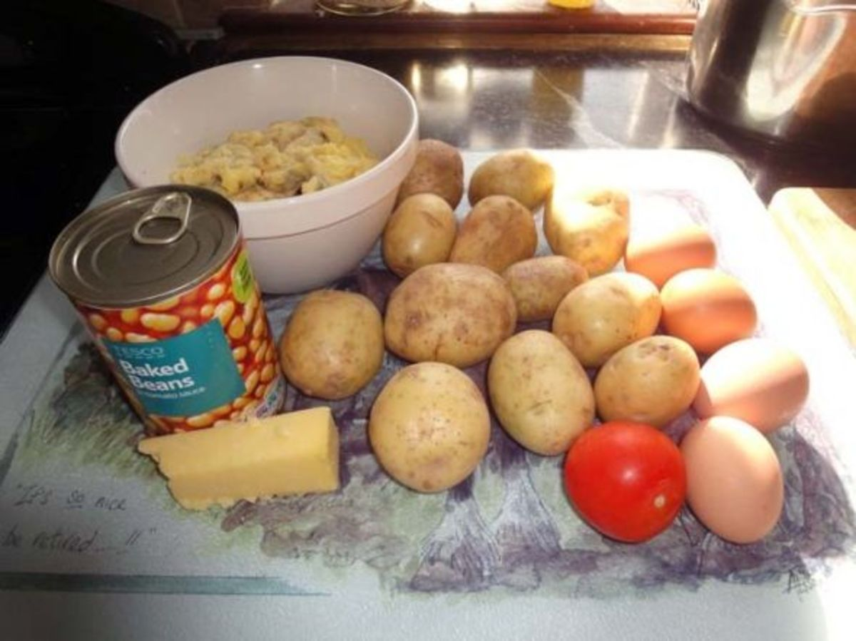 Basic ingredients for making Potato and Cauliflower Cheese Pie - Surplus Cauliflower Cheese, potatoes, tomatoes, eggs, cheese and baked beans.