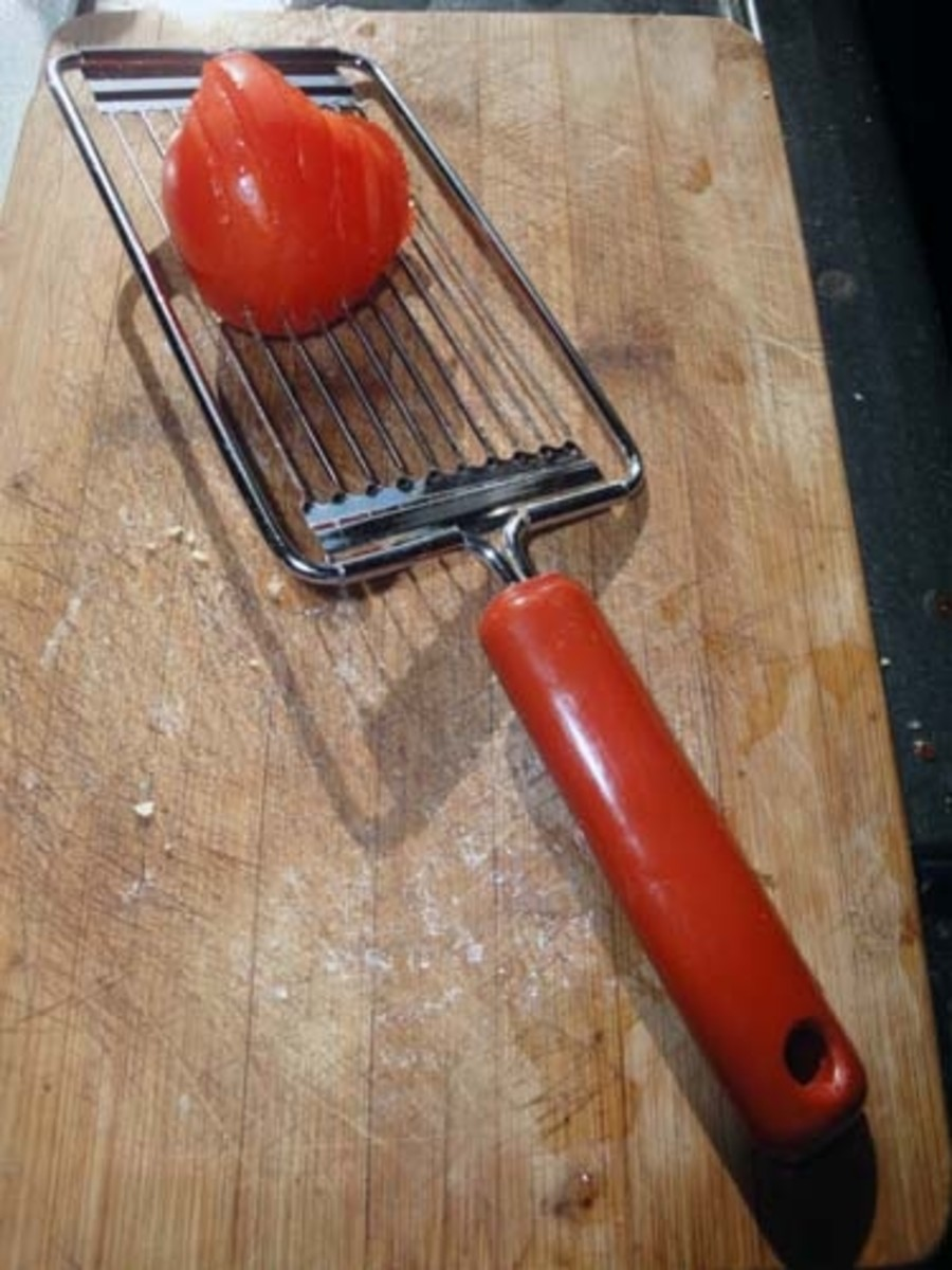 Slicing the tomato, there is a knack to using this slicer so you don't cut yourself, but once you get the knack it is a handy little utility which I find very useful.