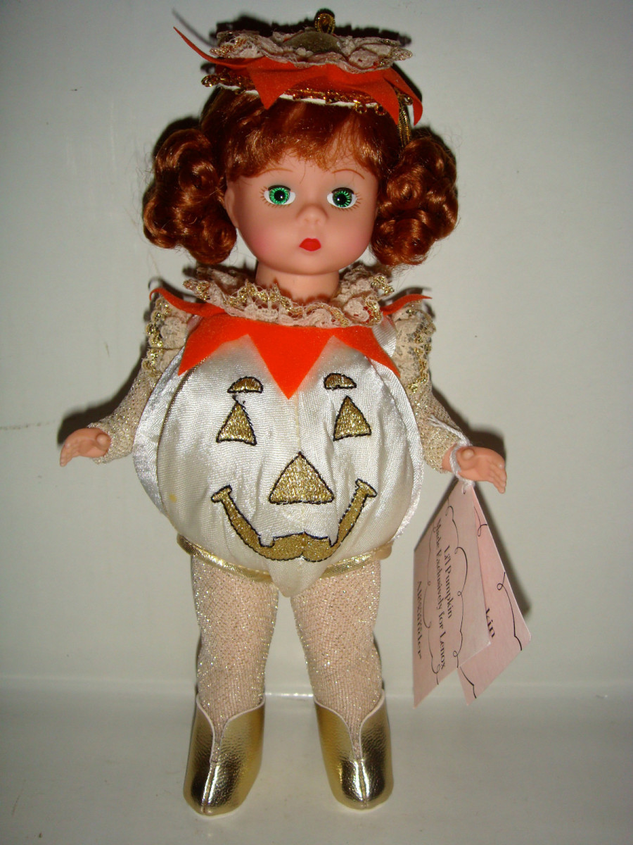 Doll with White and Gold Pumpkin by Madame Alexander