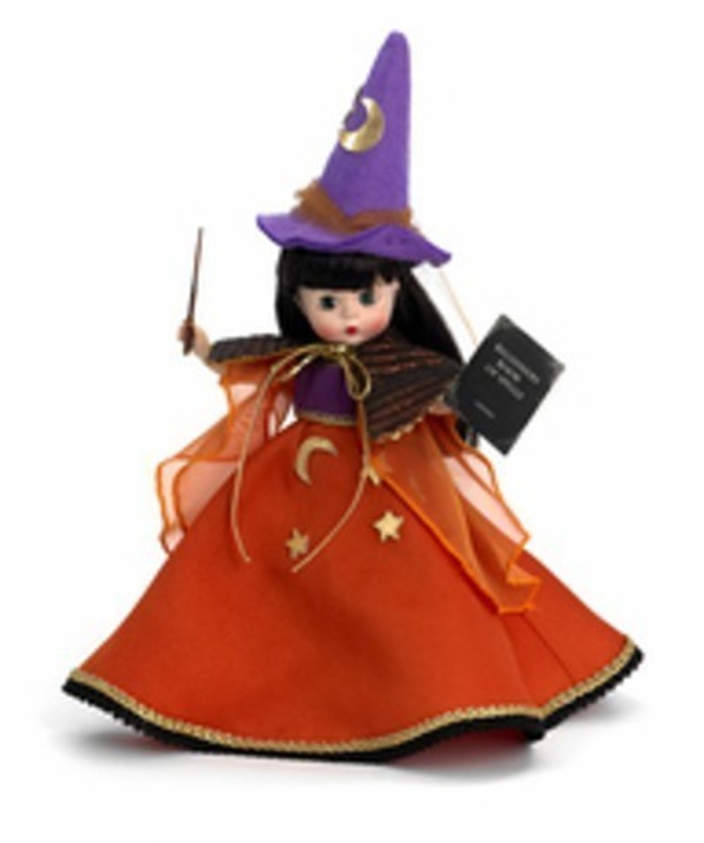 Madame Alexander Doll with Purple Witch Hat and Flowing Orange Skirt - Includes Witches' Wand