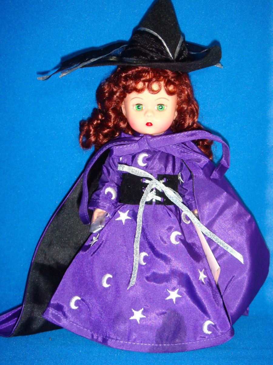 Madame Alexander Witch Dressed in Purple Flowing Cape and Dress with Black Hat