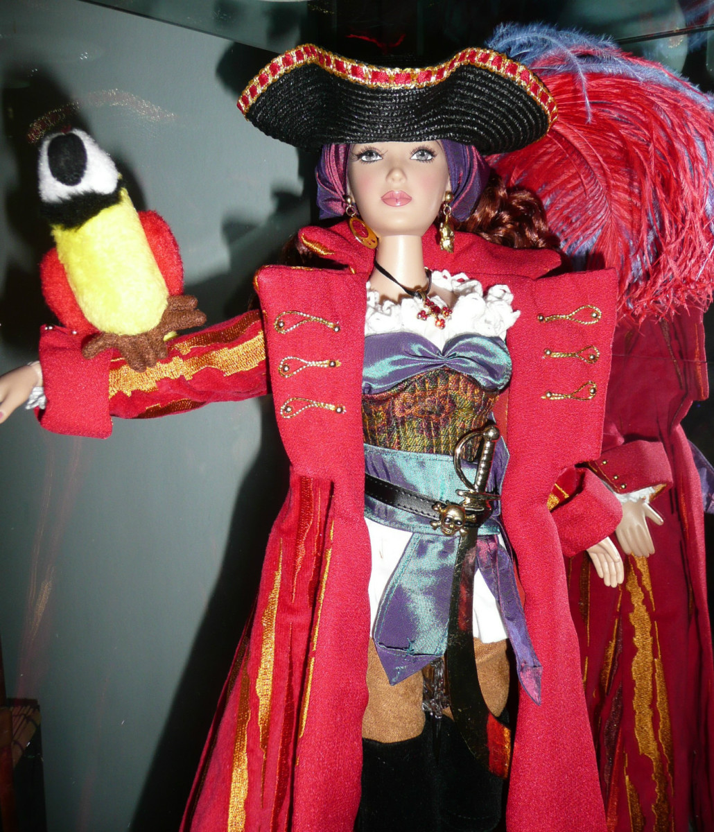 Madame Alexander Pirate Doll Set in Colorful Costume with Long Red Jacket and Pirate Hat with Feather Plumes - Includes Colorful Parrot