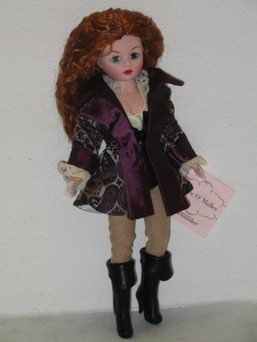 Madame Alexander Pirate Doll with Long Flowing Red Hair and Purple and Black Dress with Black Boots