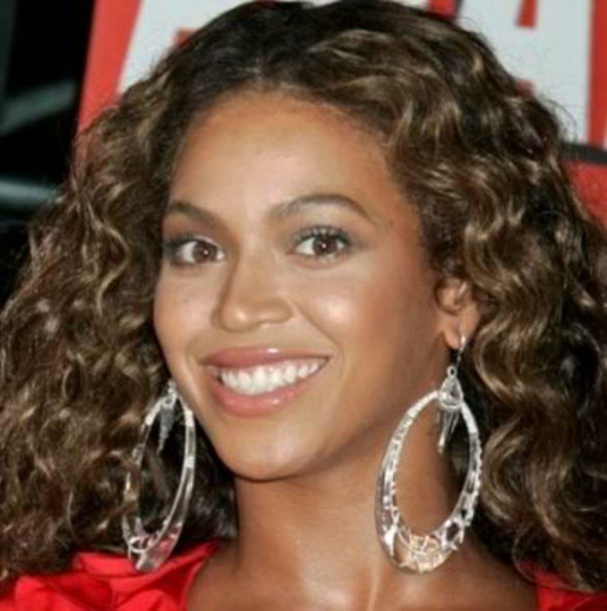 Beyonce Knowles with hook earrings