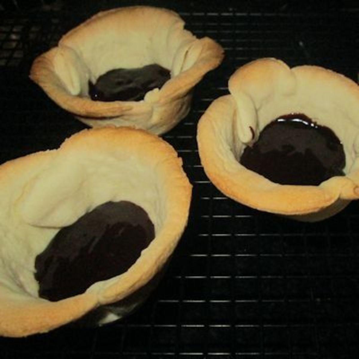 Layered in bottom of tart shells