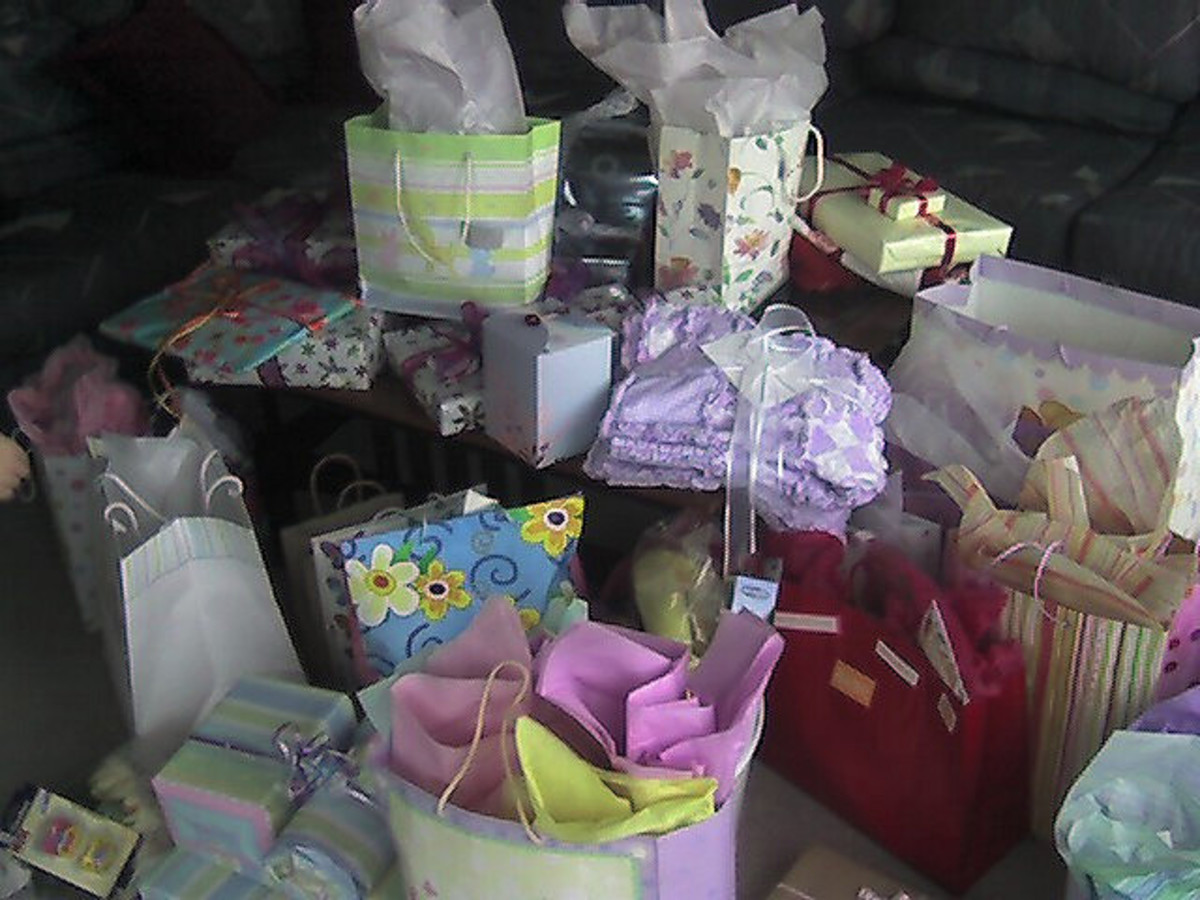 A pile of baby shower gifts