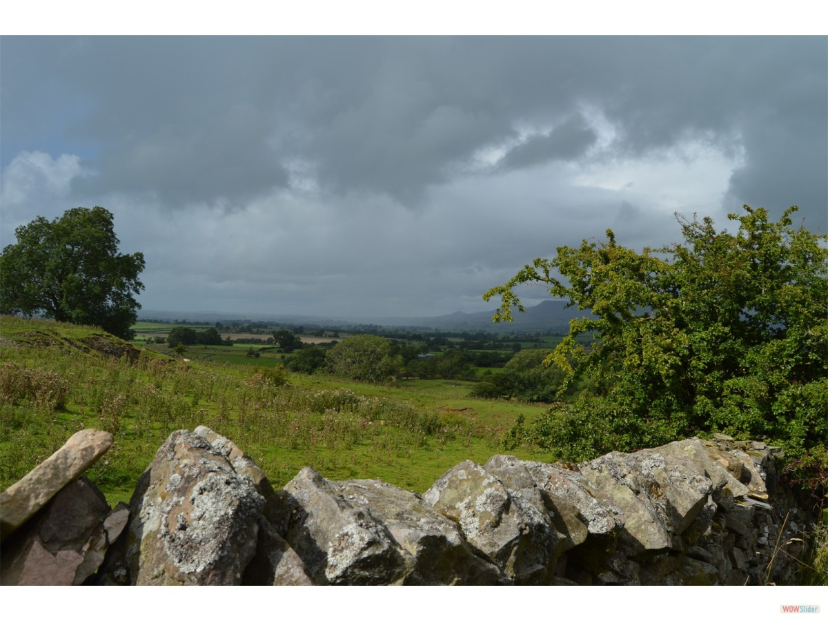 The rolling countryside around Consett, dry stone walling, pasture and extensive views west to the Durham Fell