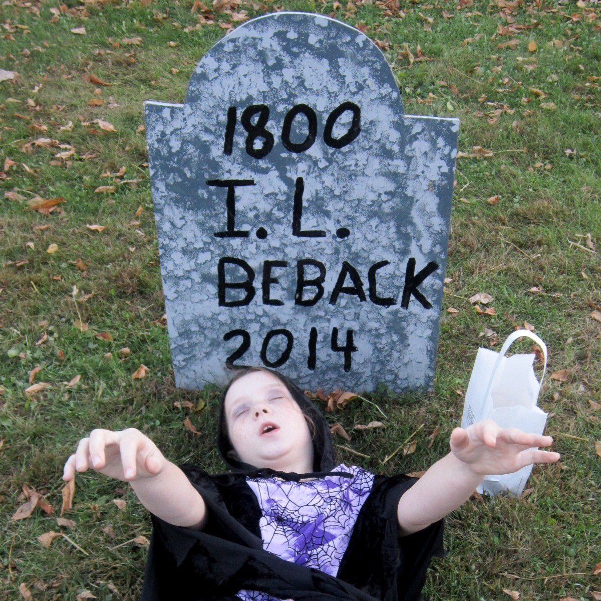 """I.L. Beback"" - Crossroads Village has its own little makeshift cemetery for Halloween. Read the creative 'names' with your kids, seeing who can get the joke first!"