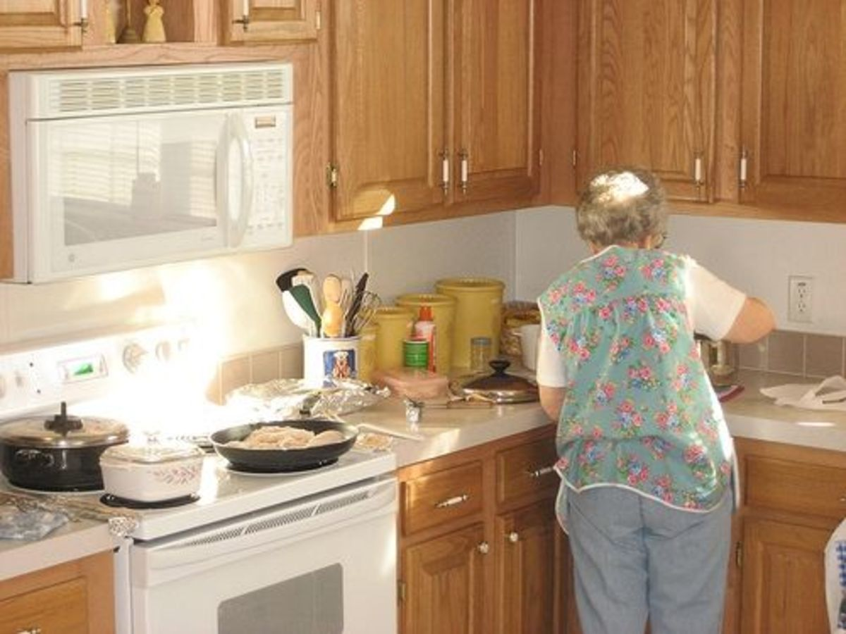 Grandma wearing cobbler apron in her kitchen