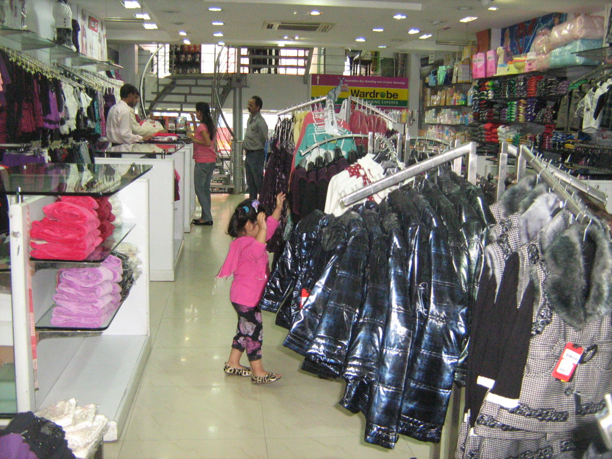 Paul Garments kids section displaying winter wear for girls.