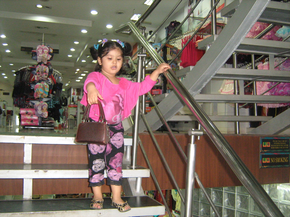 My daughter, Shronika Soni, stepping out from the ground floor of Paul Garments in Rajouri Garden in New Delhi.