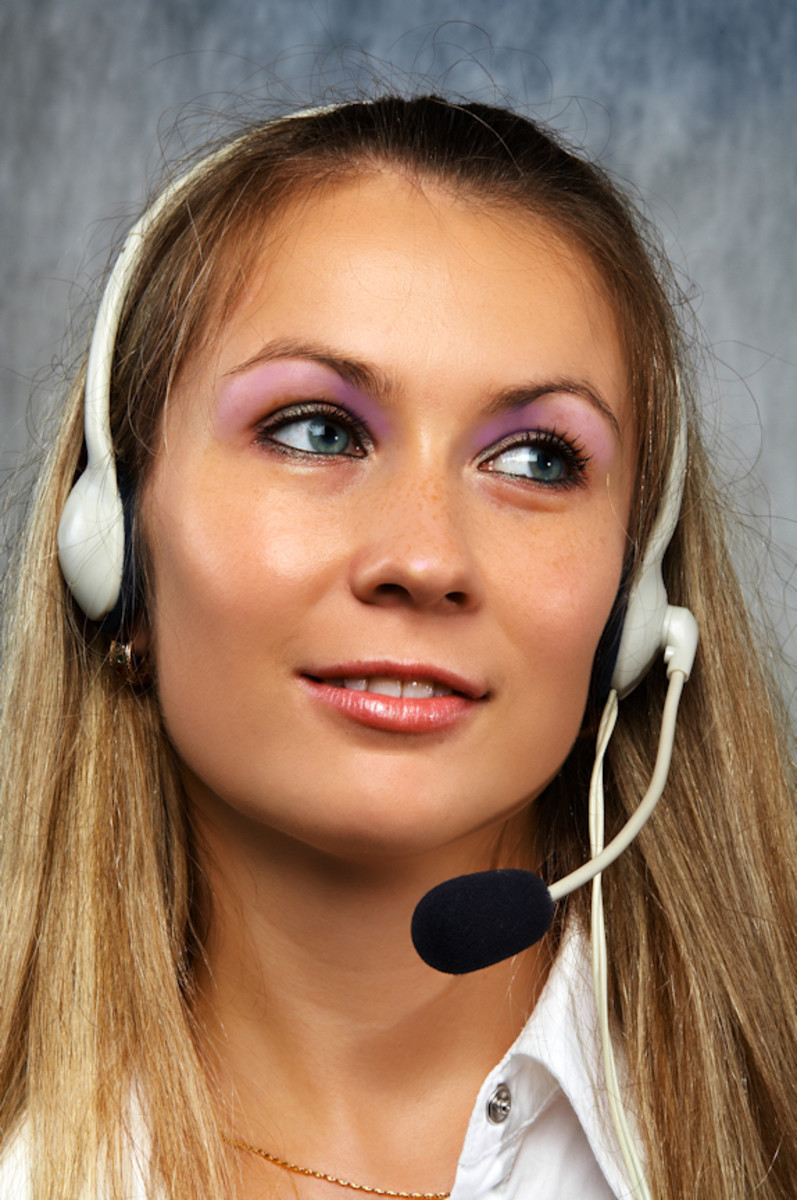 Call Centre female with free hands, headphone and microphone. Having the right equipment can help towards making successful calls.