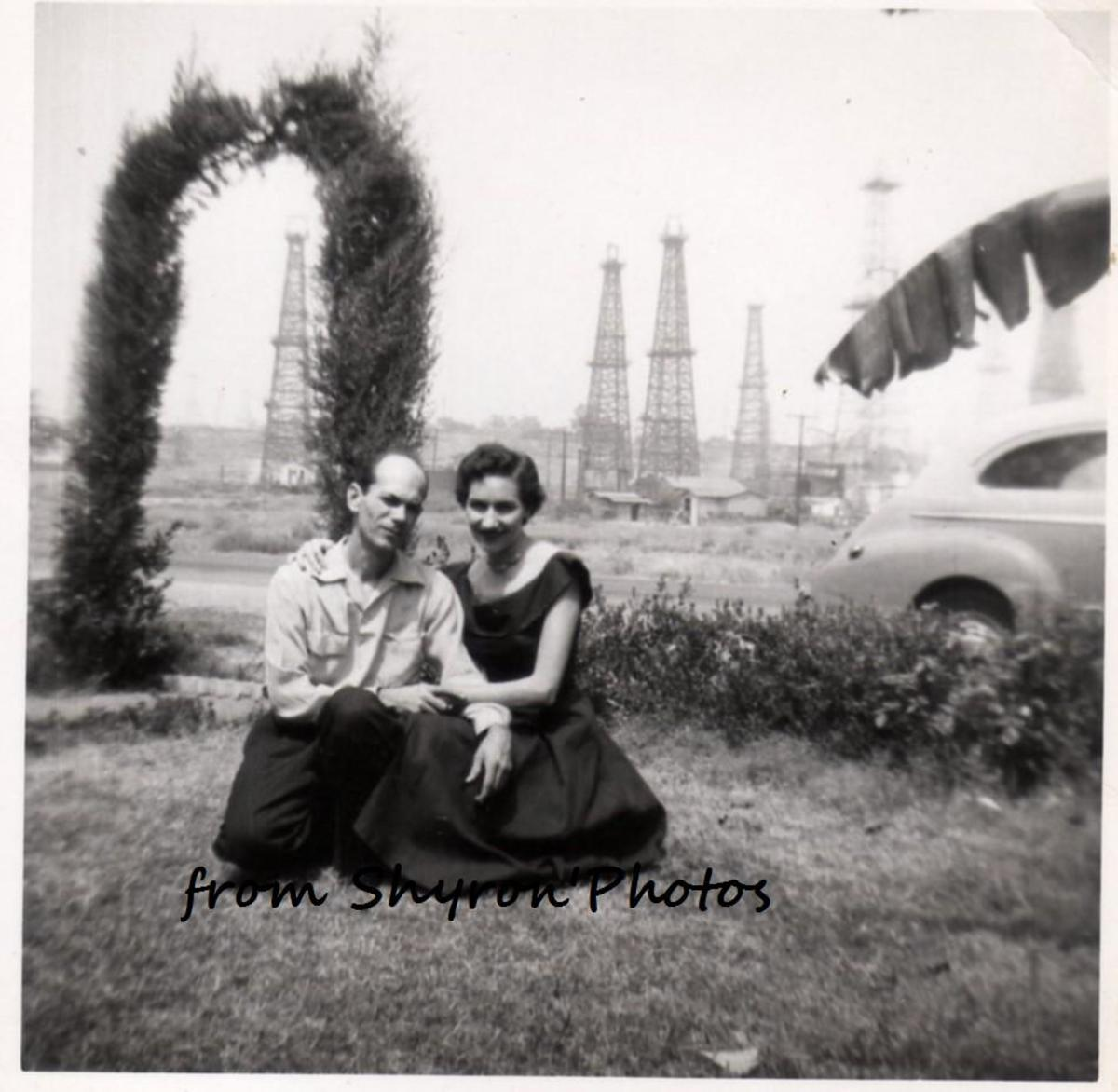 Dad and Mom the day after we moved into the house in California. You can see the oil wells where we found the pigeon.