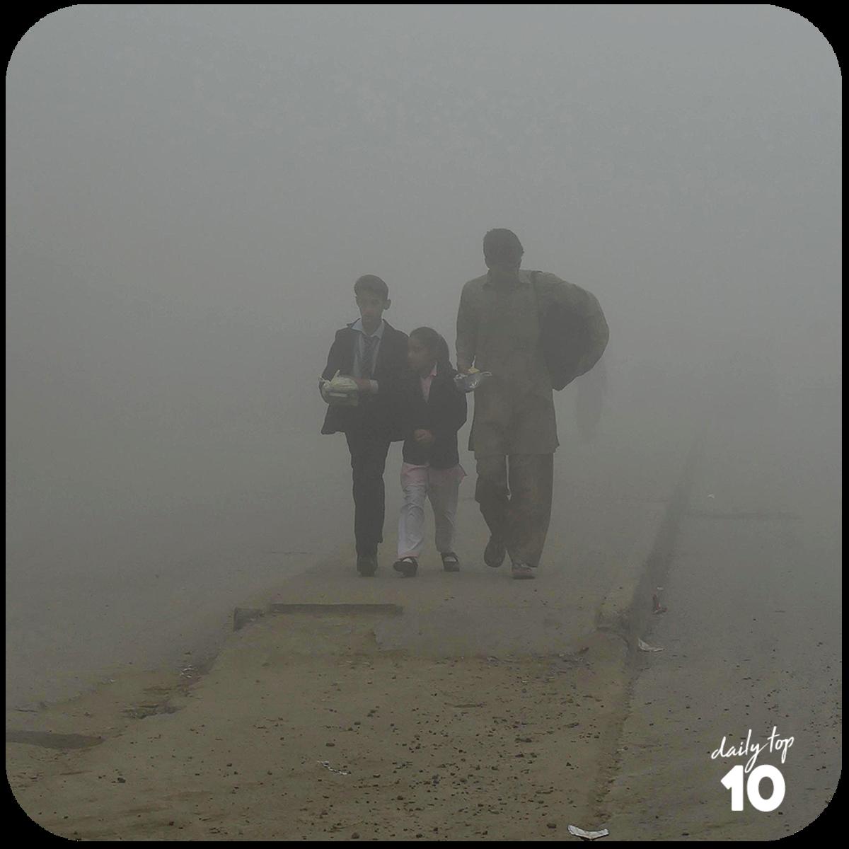 A family walks their way through a smog.