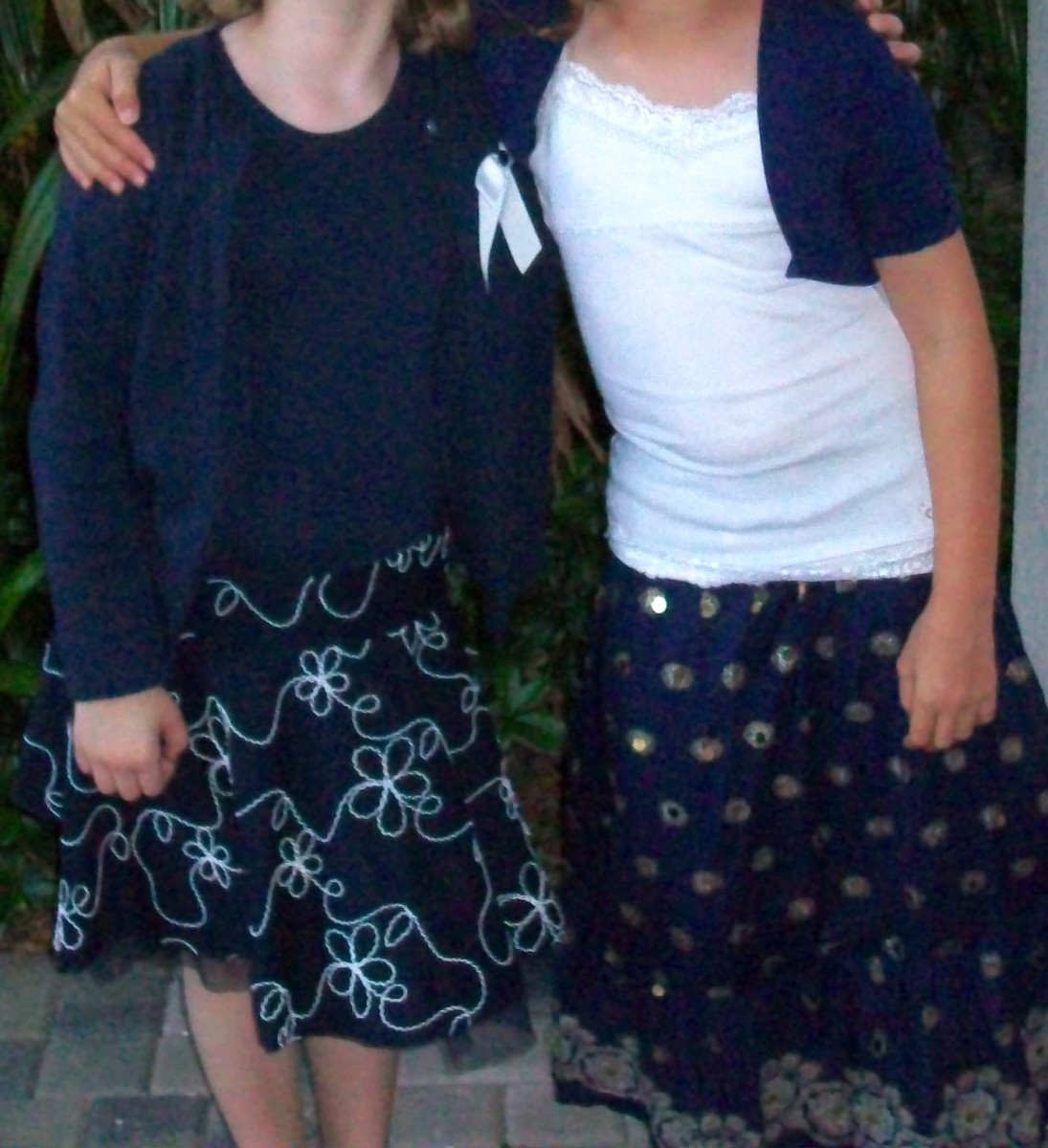 Two girls dressed for synagogue