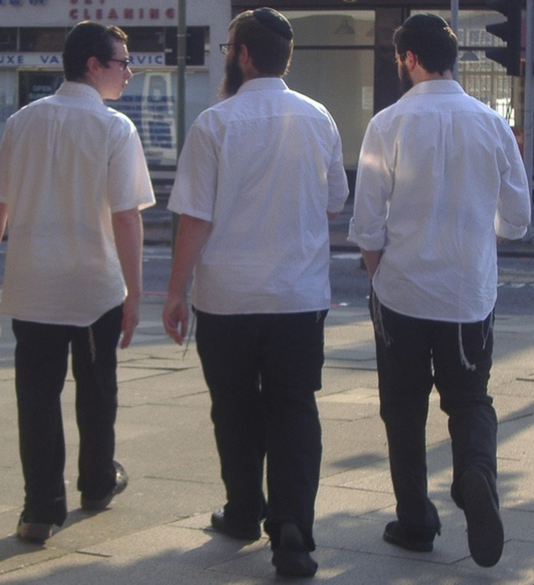 Orthodox men dressed Israeli-style. This photo was not taken on Shabbat, so they are not as neat as they would be for going to shul.
