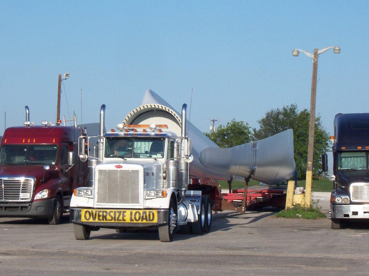 Wind turbine sans blades on back of a truck at a Texas truck stop, on its way to a West Texas wind farm.