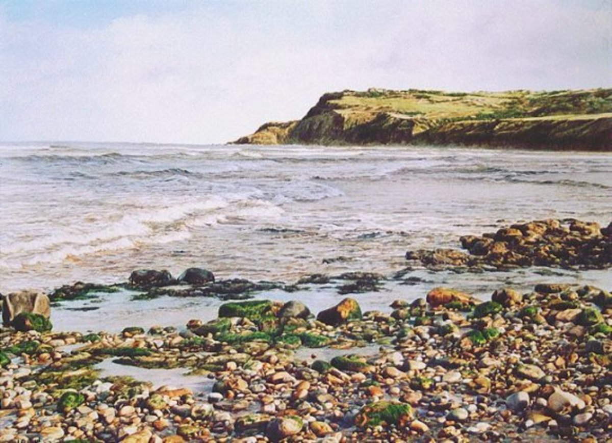 Ravenscar - or Peak - from the beach at Bay Town, Robin Hood's Bay. Painting by Megan Burford