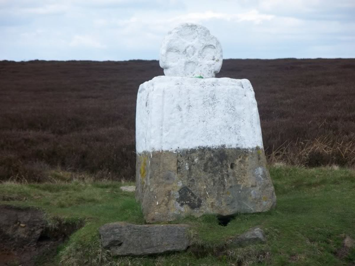 A little way on from the Lion Inn, meet Fat Betty. She won't hurt you, go on up and greet her (she's a worn old waymarker cross) and take something. Leave something in exchange, though, or you might just be cursed!
