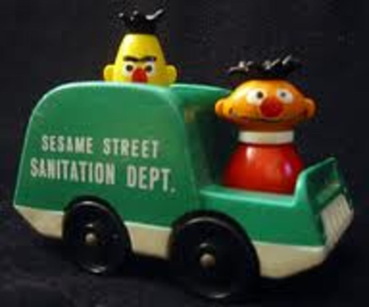 Ernie and Bert in a garbage truck.  Where's Oscar when you need him?