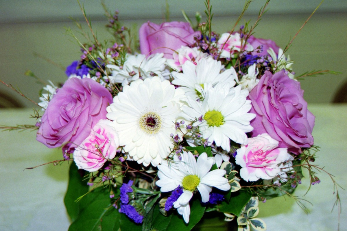 A special pot of blooms brings happiness to a woman on her special milestone birthday at any age.