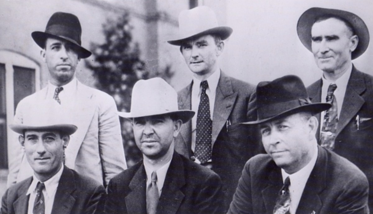 "LEFT TO RIGHT, STANDING: Ted Hinton, Prentiss Oakley & B.M. ""Maney"" Gault SITTING: Bob Alcorn, Henderson Jordan and Frank Hamer"