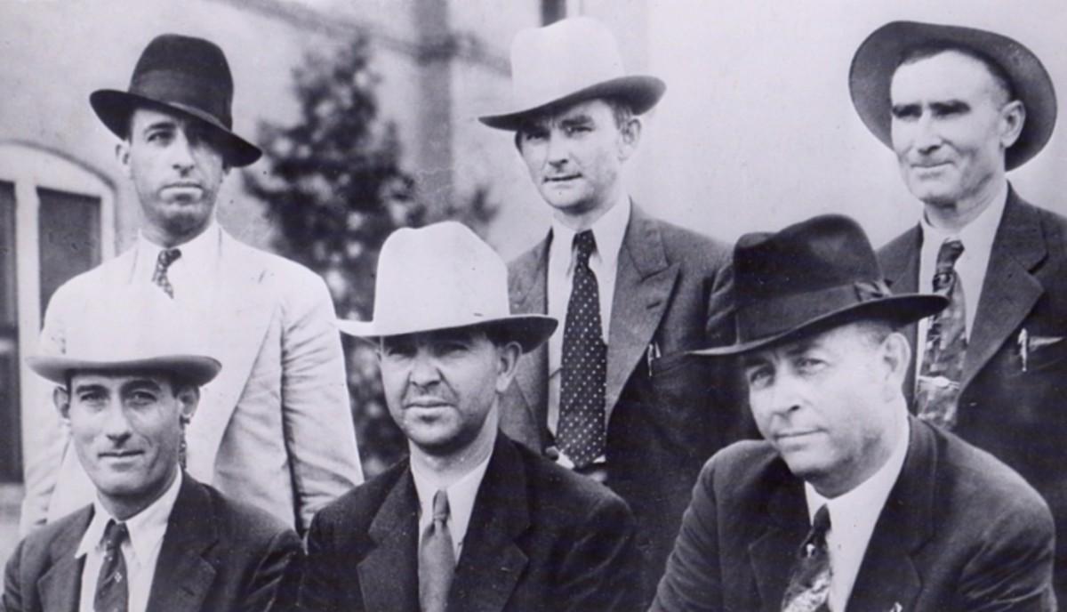 "LEFT TO RIGHT, STANDING: Ted Hinton, Prentiss Oakley & B.M. ""Maney"" Gault SITTING: Bob Alcorn, Henderson Jordan and Frank Hamer"