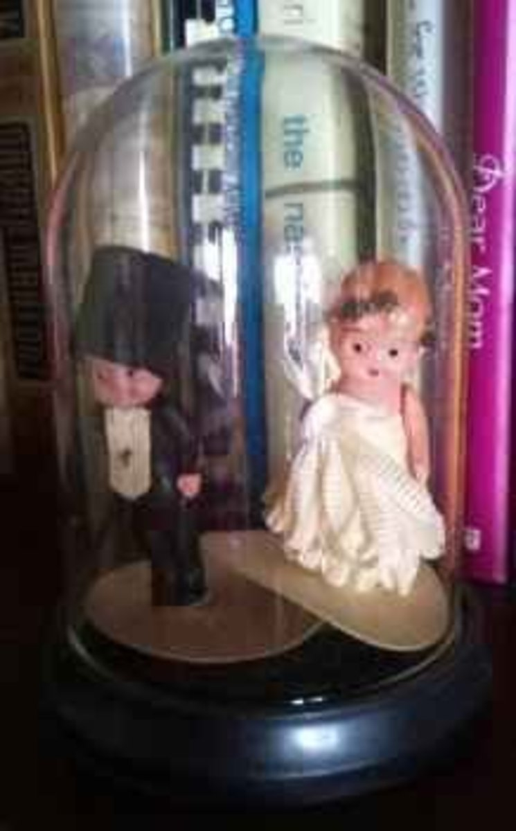 Not authentic kewpies, but sweet little wedding cake toppers that were part of the kewpie craze.