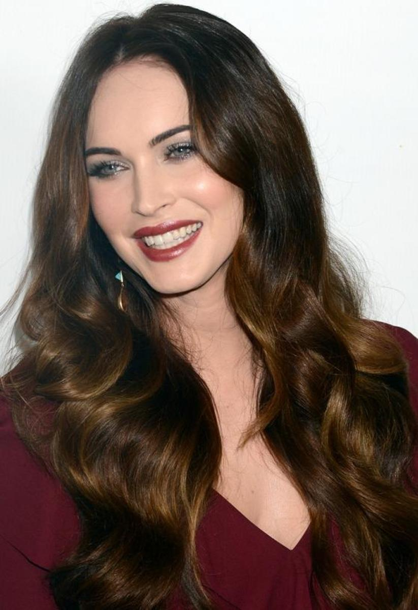 Pictures of celebrities with dark brown hair and blonde highlights.