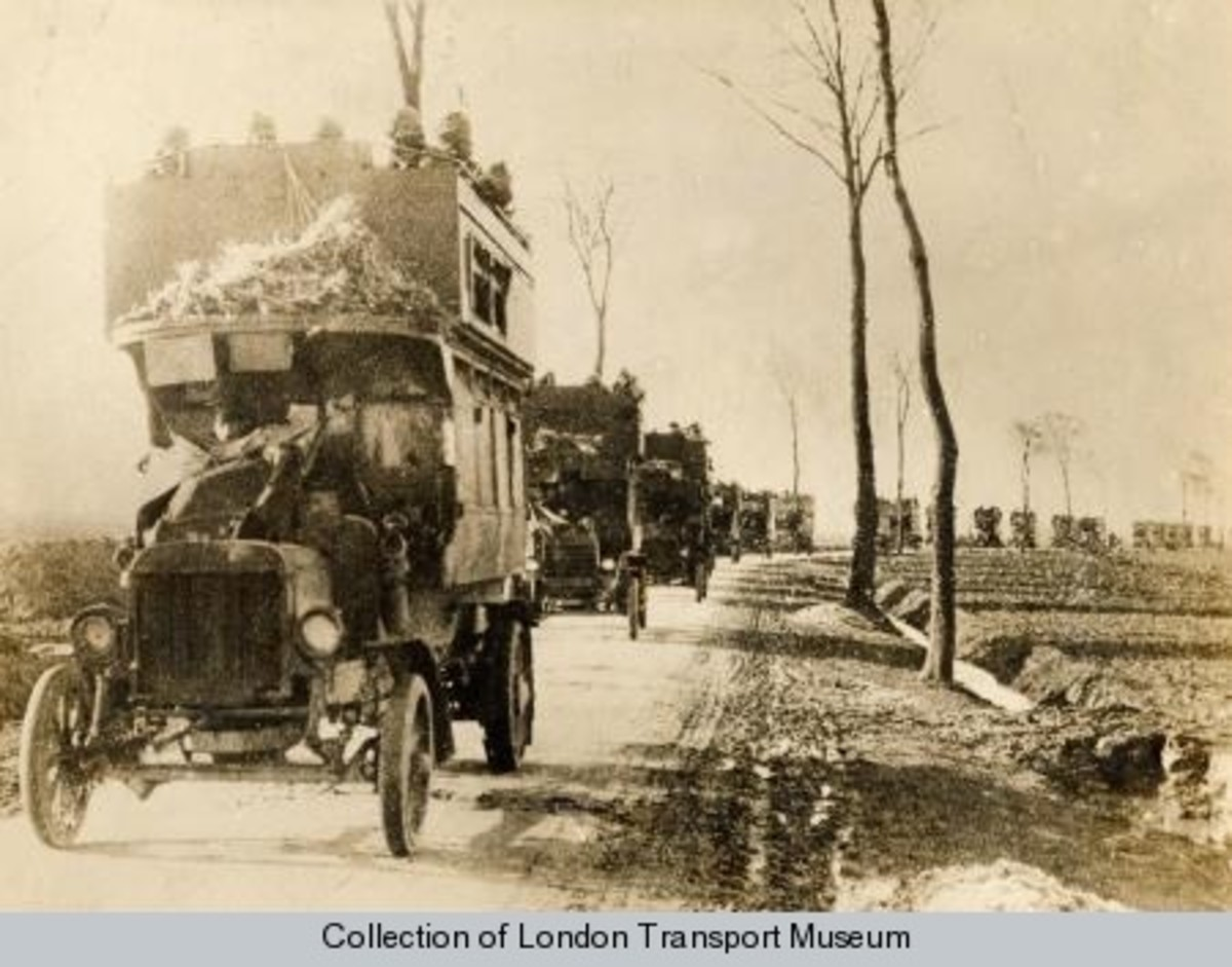 A line of London buses commandeered to move troops to the front line.