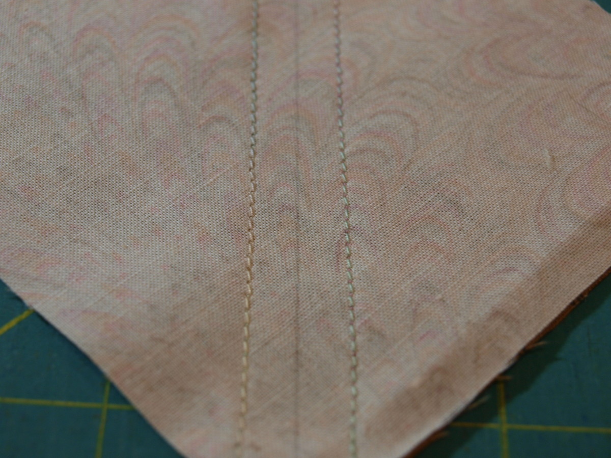 "2. Using a 1/4"" seam, sew down each side of the drawn line."