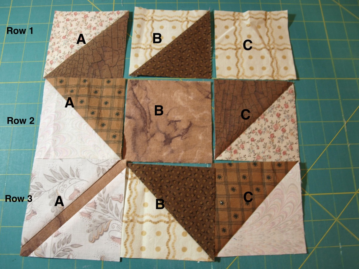 Laying out the squares in the leaf pattern when preparing the block for sewing.