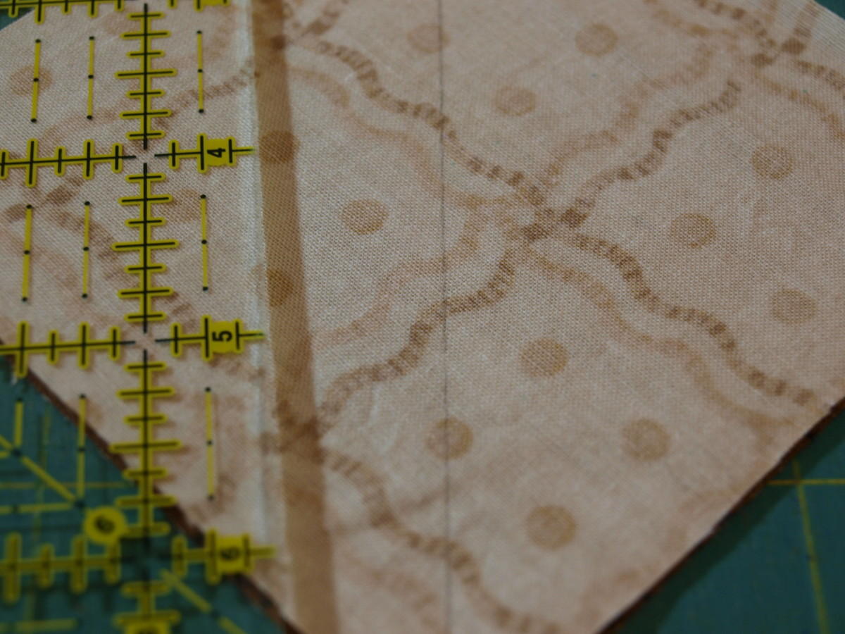 "1. Place one light 4"" square right sides together with one dark 4"" square.  Draw a line diagonally across the light square as a sewing guide."