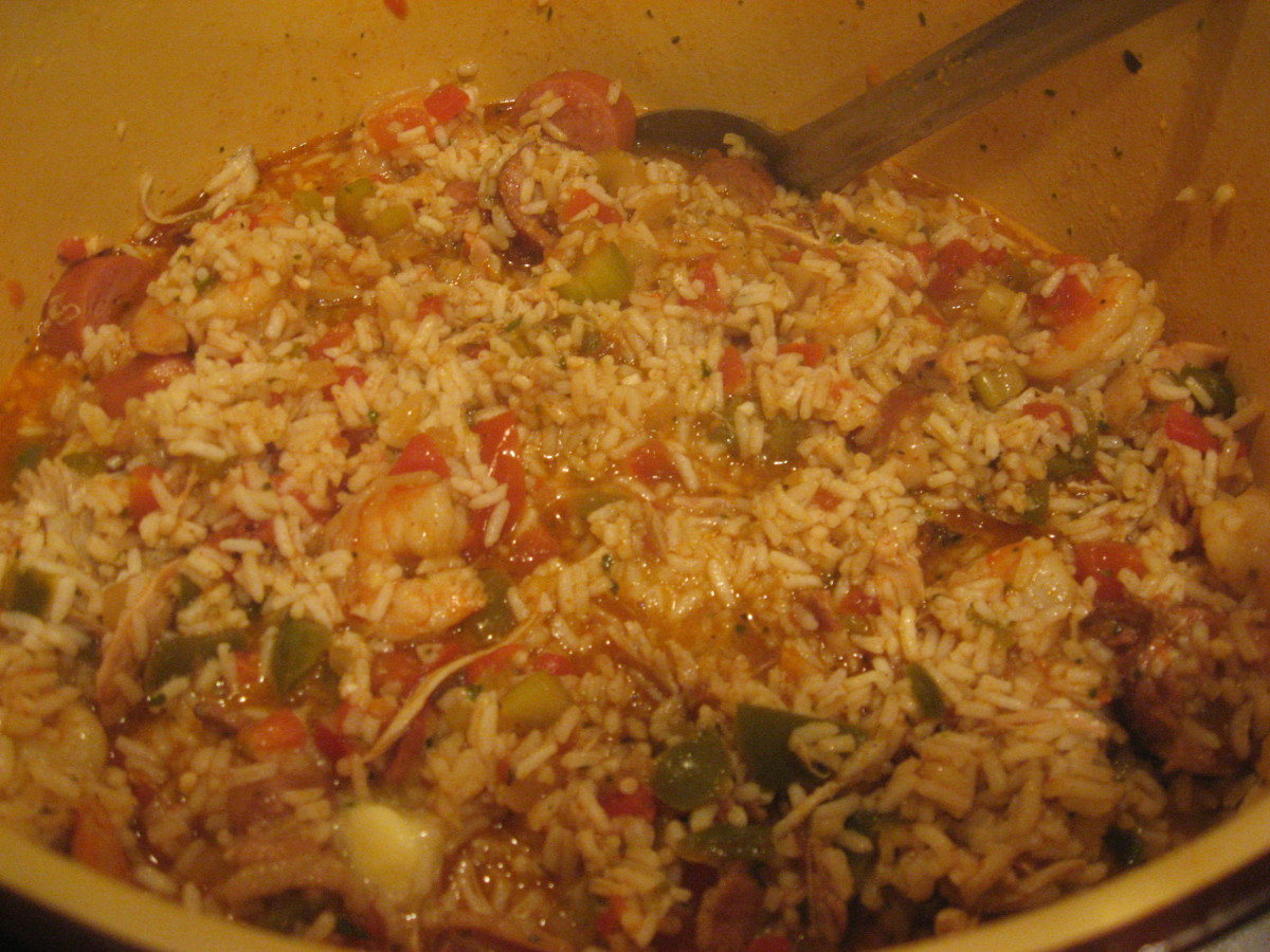 Add broth, tomatoes, seasonings, rice, meat, and butter.