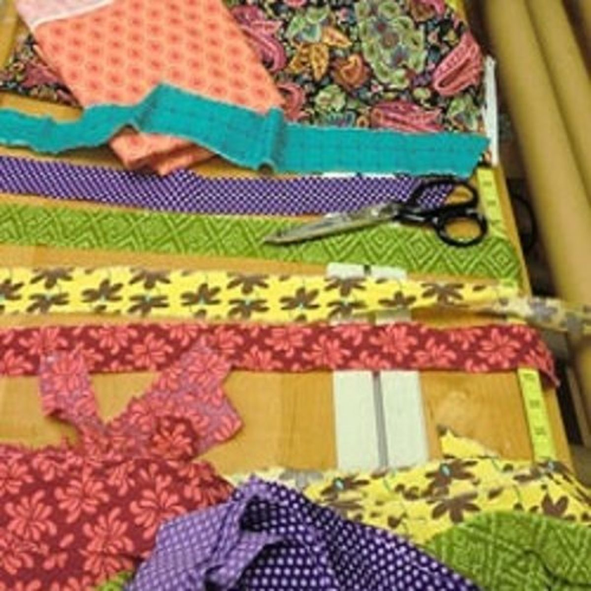 Supplies Needed:  1. 5-7 yards of assorted craft/quilting fabrics (Note: some less expensive fabrics do not tear straight)  2. Curtain backing, if desired, such as pre-made sheers, burlap panels, or light/heat blocking curtains  3. Sewing machi
