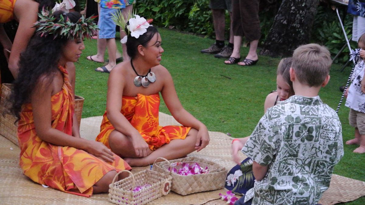 Making leis at a luau in Hawaii