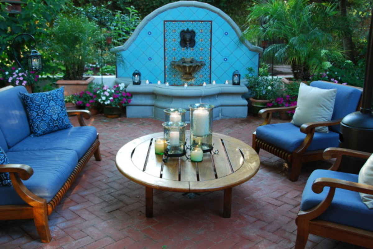 Mediterranean patio designed with blue tile fountain and brick floor