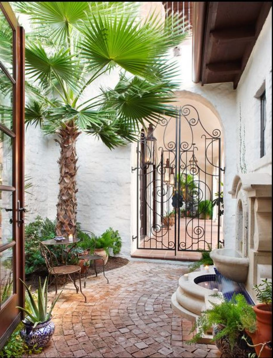 Mediterranean iron gate with brick outdoor flooring