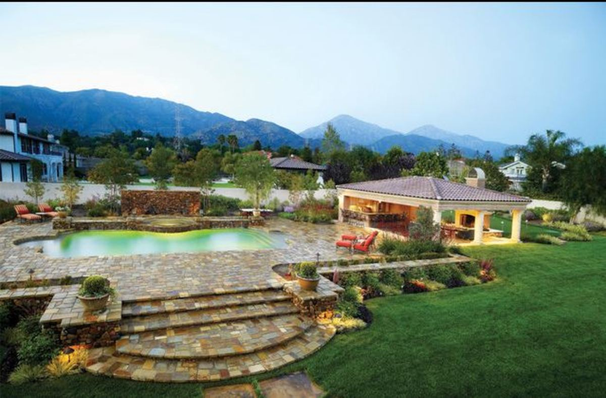 Mediterranean patio with swimming pool and extensive stone