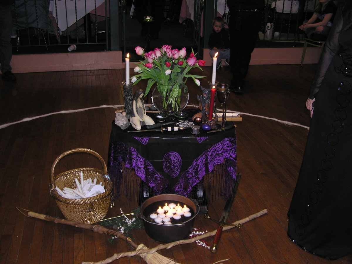 A simple altar decorated for Imbolc.