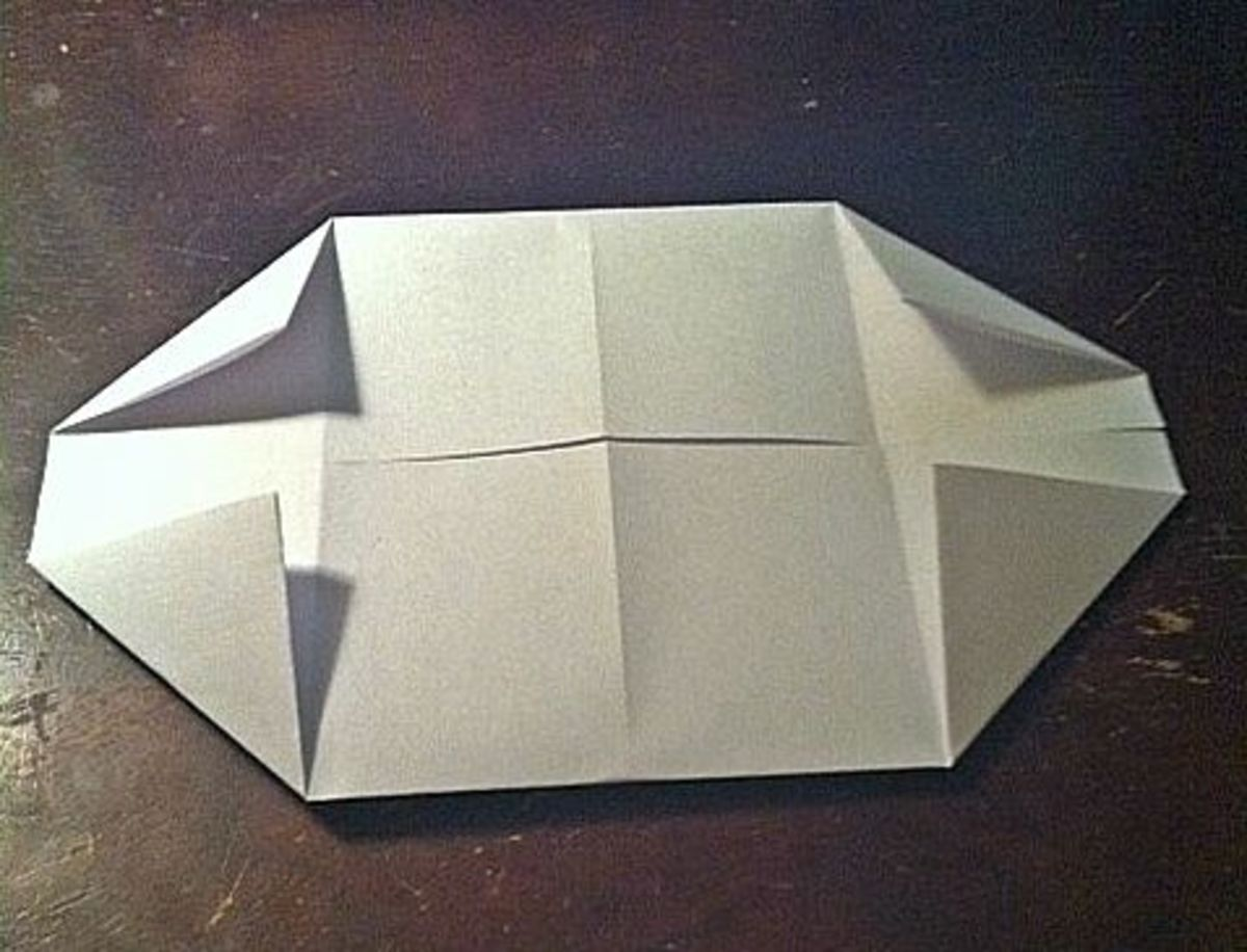 Fold all corners to the first crease.