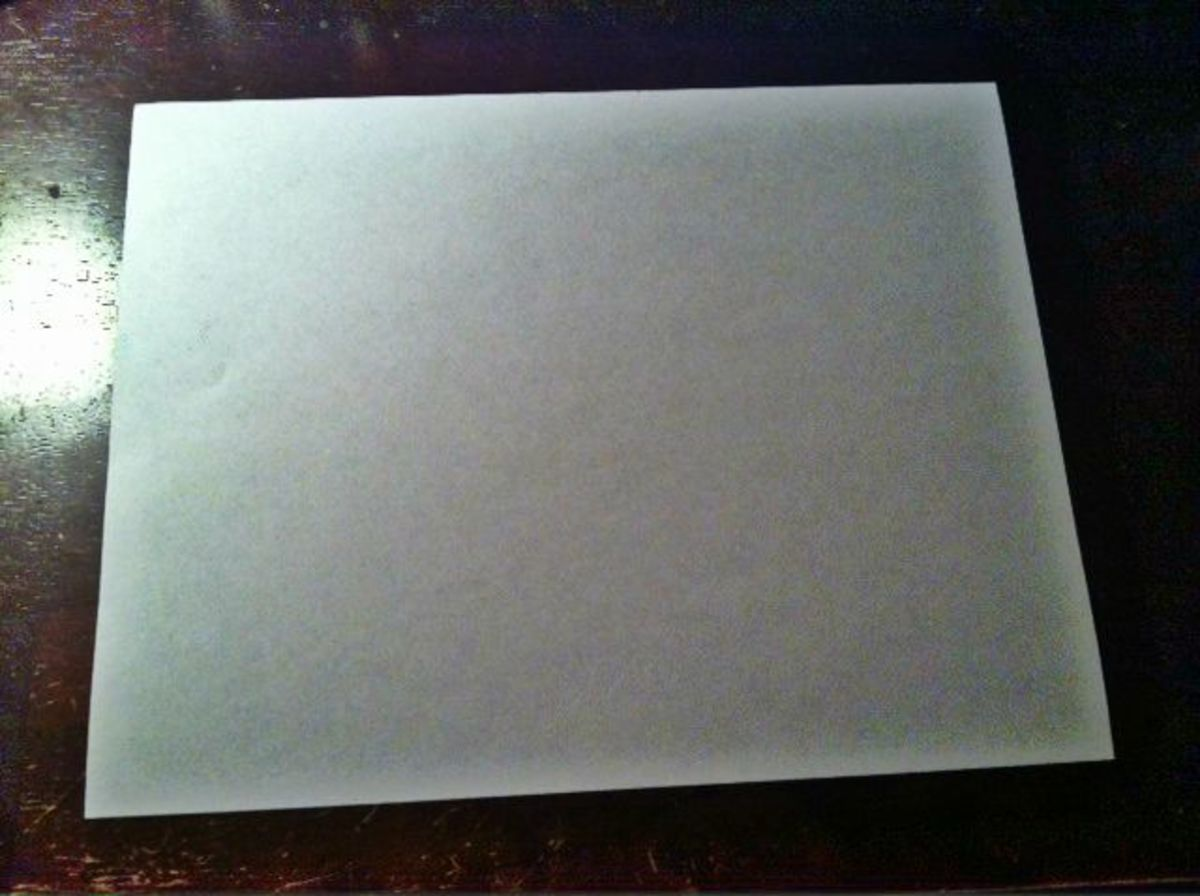 Lay a piece of paper on a flat surface.