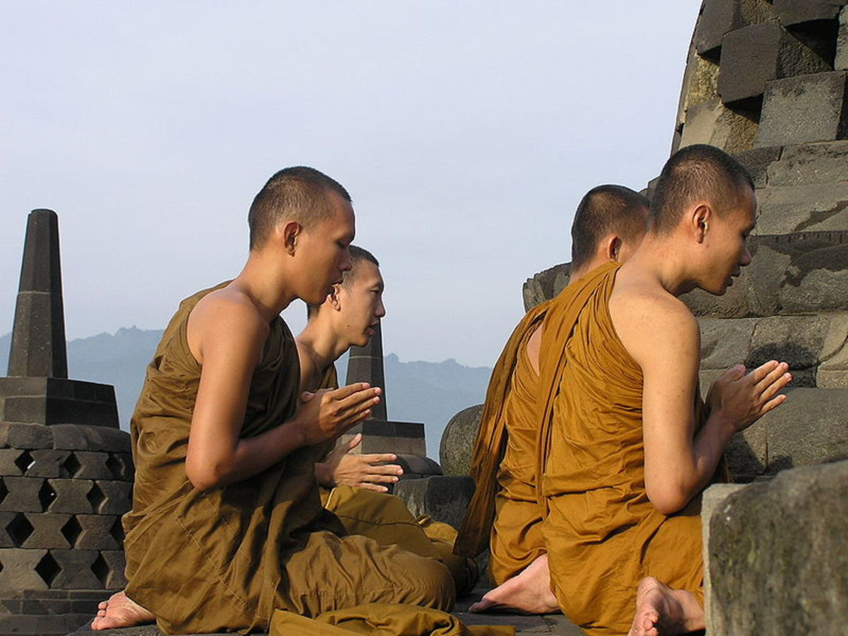 Buddist monks praying at Borobudur, central Java, Indonesia