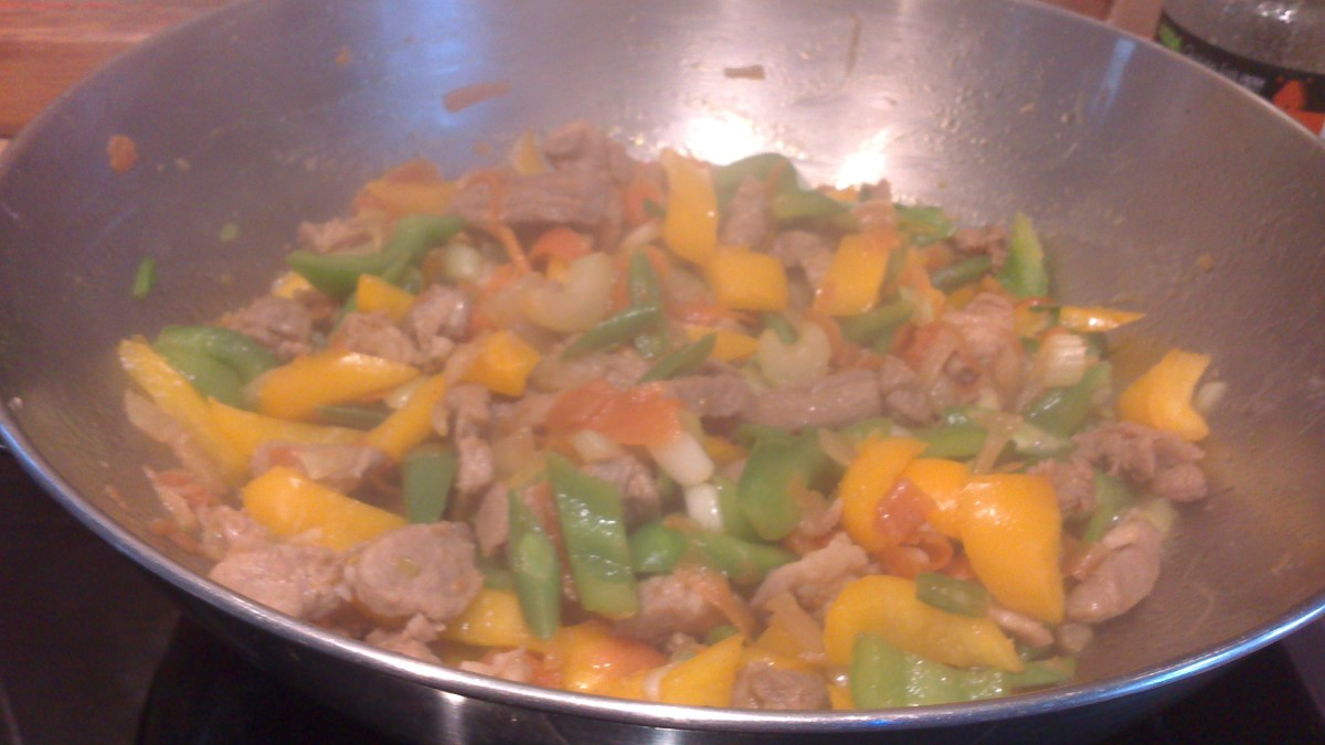 Pork Stir Fry with yellow and green capsicum or bell pepper and carrots, different ingredients