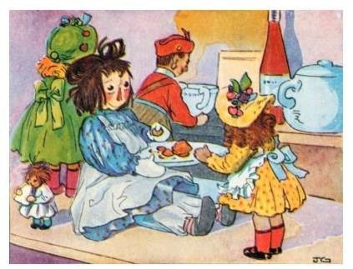 Raggedy Anne playing with other dolls
