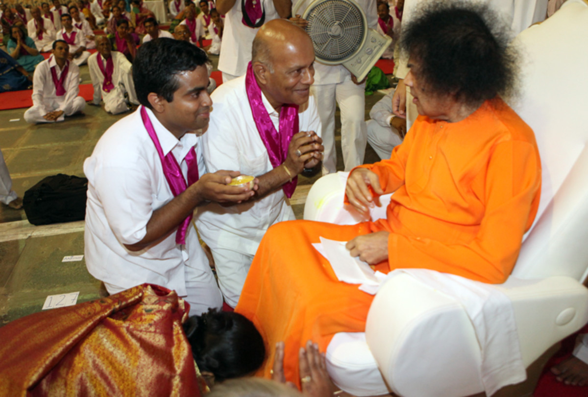 Mother takes namaskar as Swami speaks to father and me...