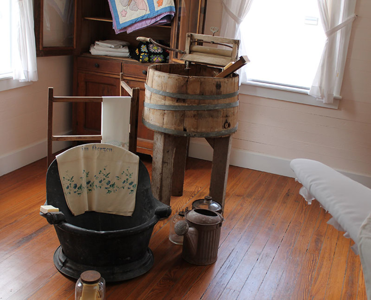 Most all the family bathing and laundry washing occurred in or close to the kitchen pitcher pump and wood stove used to heat the water.