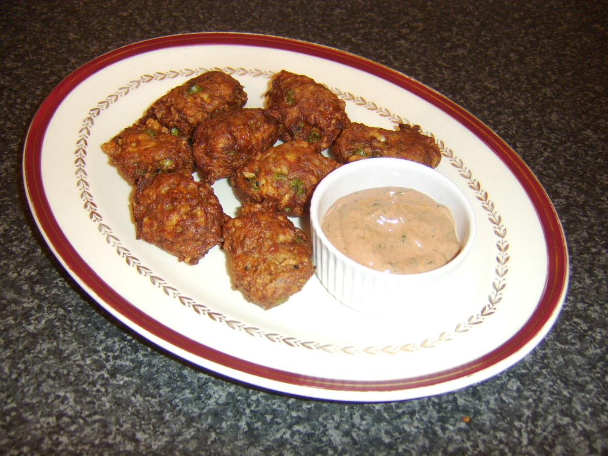 Chicken and vegetable fritters with pakora spices served with an easy to make pakora sauce