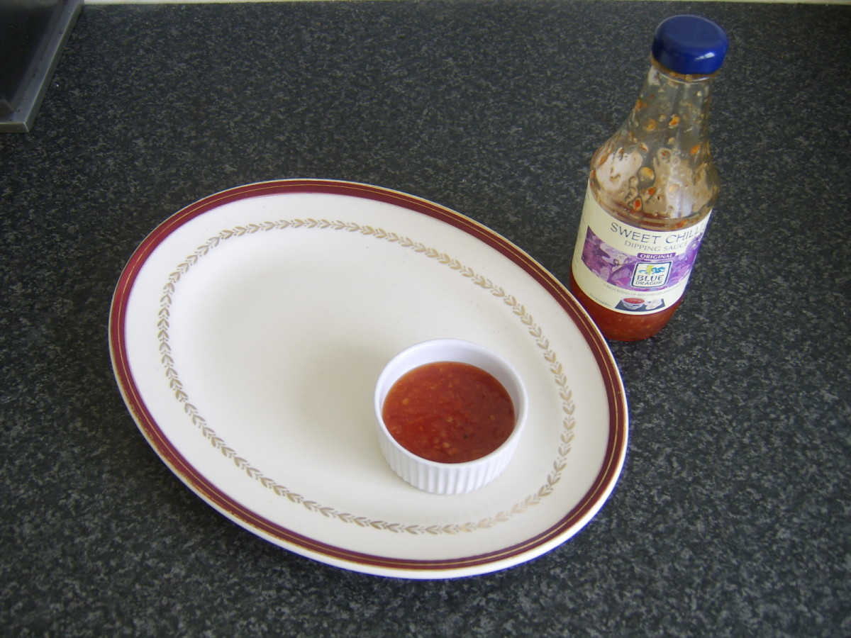 Sweet chilli dipping sauce is served in a small ramekin