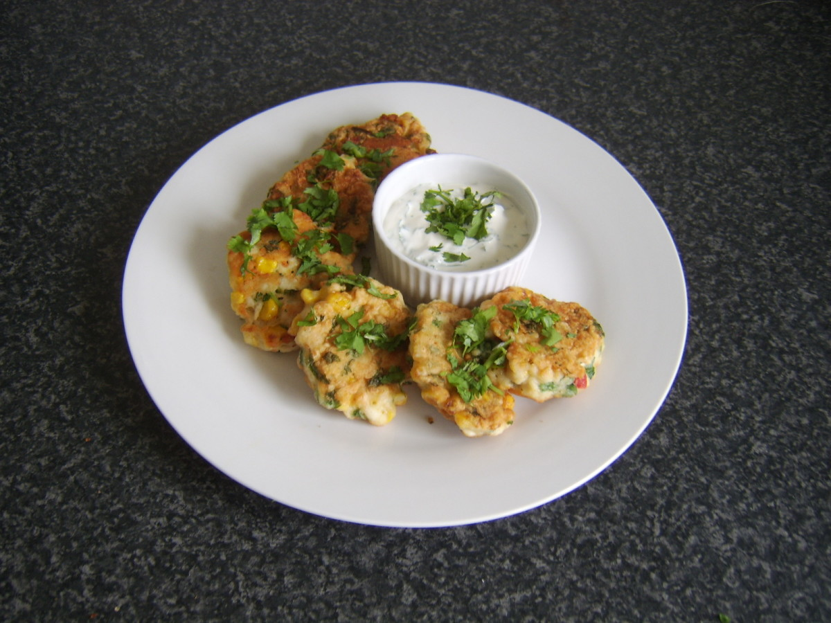 Shallow fried chicken, sweetcorn and pepper fritter served with a soured cream and garlic dip